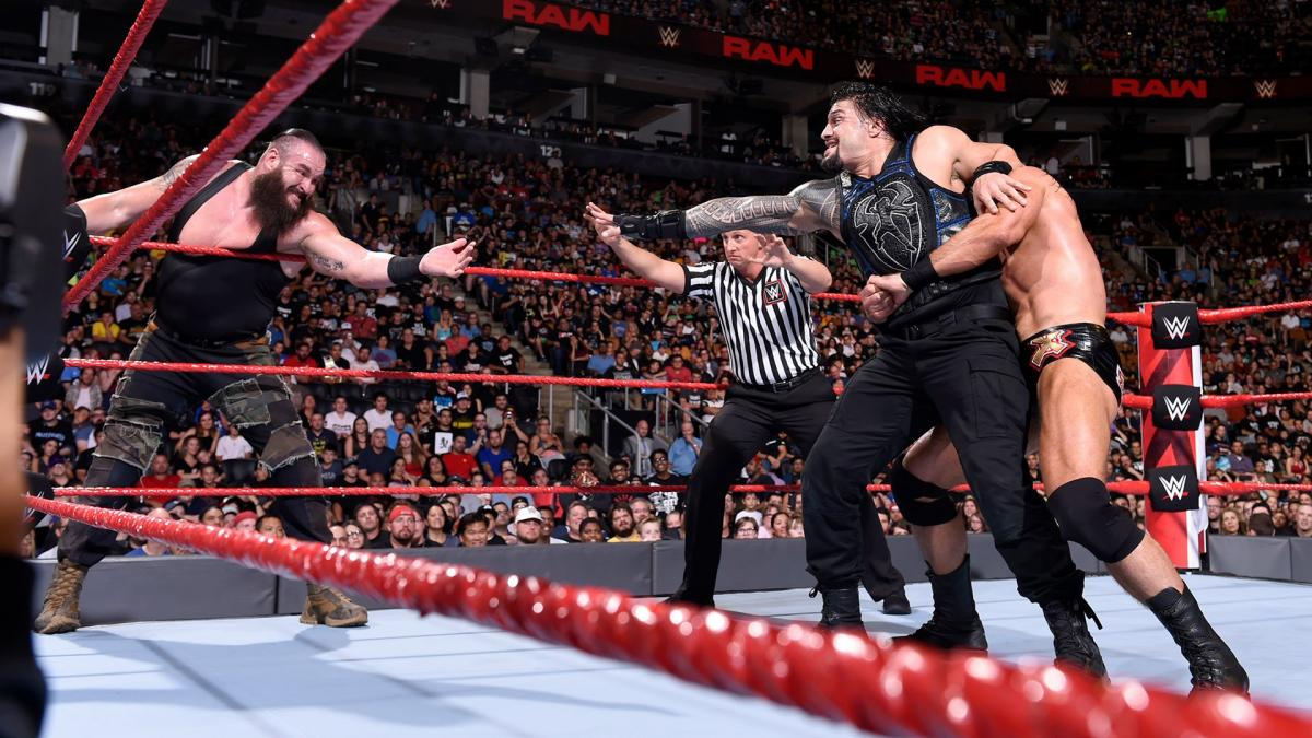 Roman Reigns struggles to tag in Braun Strowman. (source: WWE)