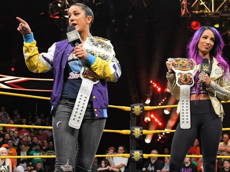 Sasha Banks and Bayley with the WWE Women's Tag Titles