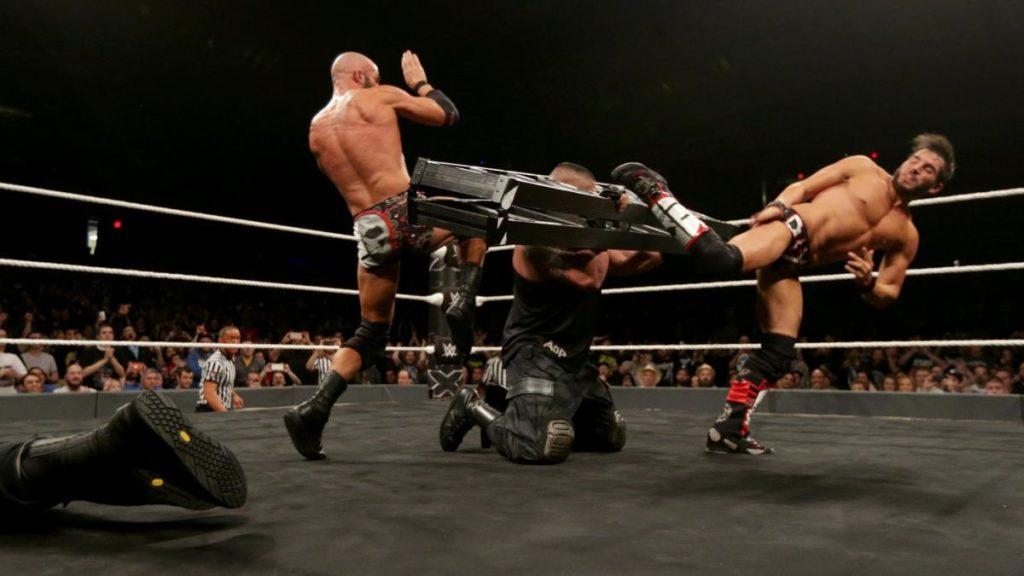 DIY meet AoP in the middle. (source: WWE)