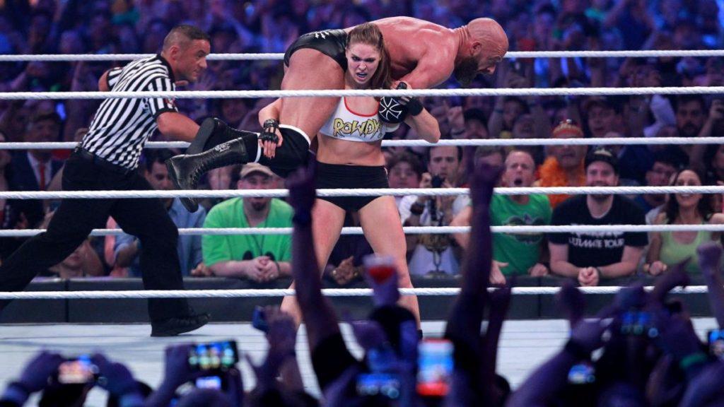 Triple H, Ronda Rousey (source: WWE)