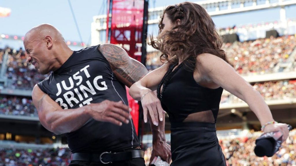 The Rock, Stephanie McMahon (source: WWE)