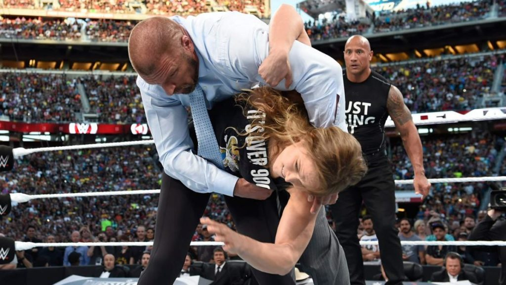 Triple H, Ronda Rousey, The Rock (source: WWE)