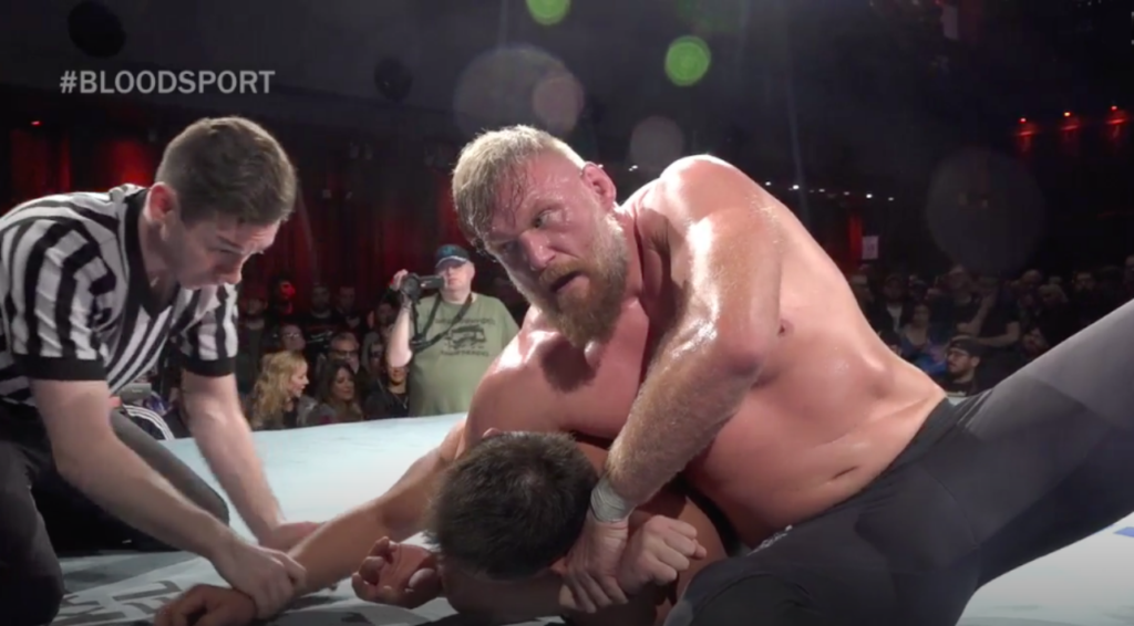 Josh Barnett applies a headlock at Bloodsport. (Source: GCW)