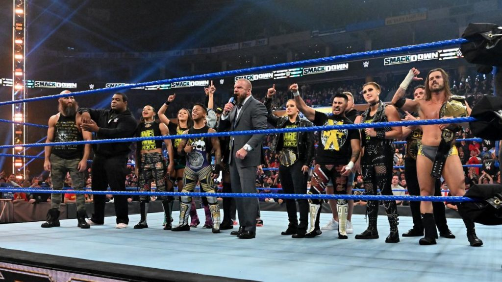 Triple H & the NXT roster (source: WWE.com)