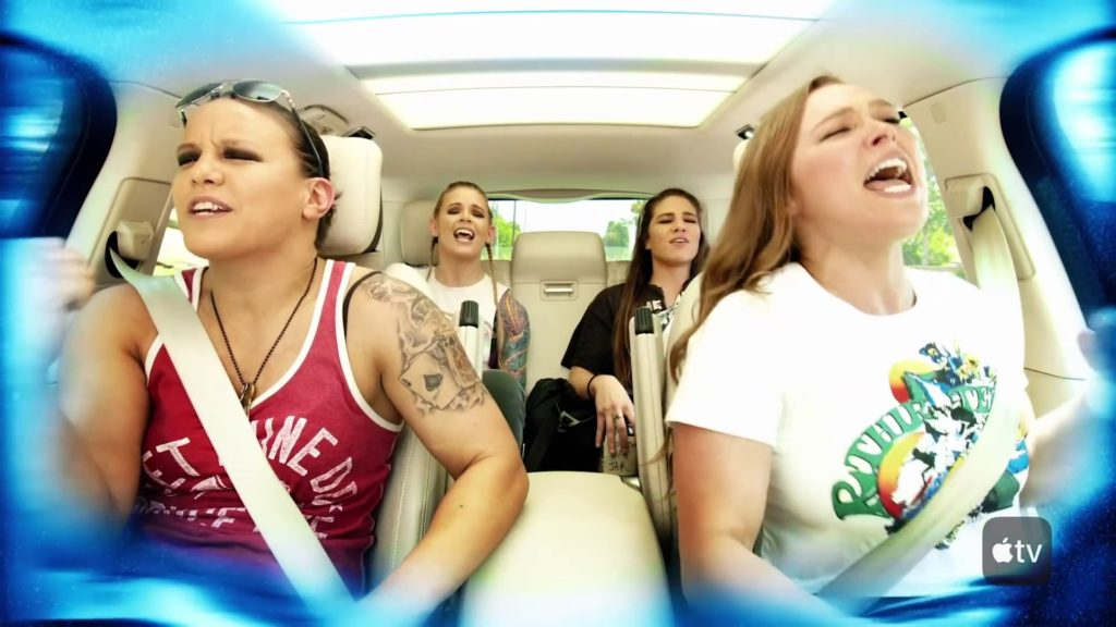 The Four Horsewomen (Shayna Baszler, Jessamyn Duke, Marina Shafir, and Ronda Rousey) singing their hearts out (source: Apple TV)