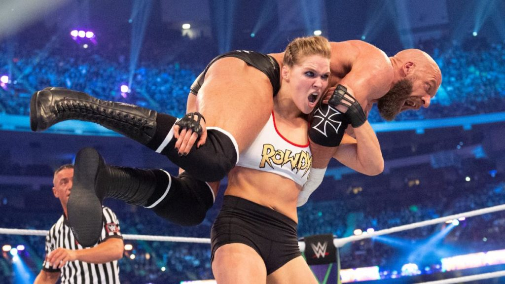 "Ronda Rousey, giving ""The Game"" the business (source: WWE)"