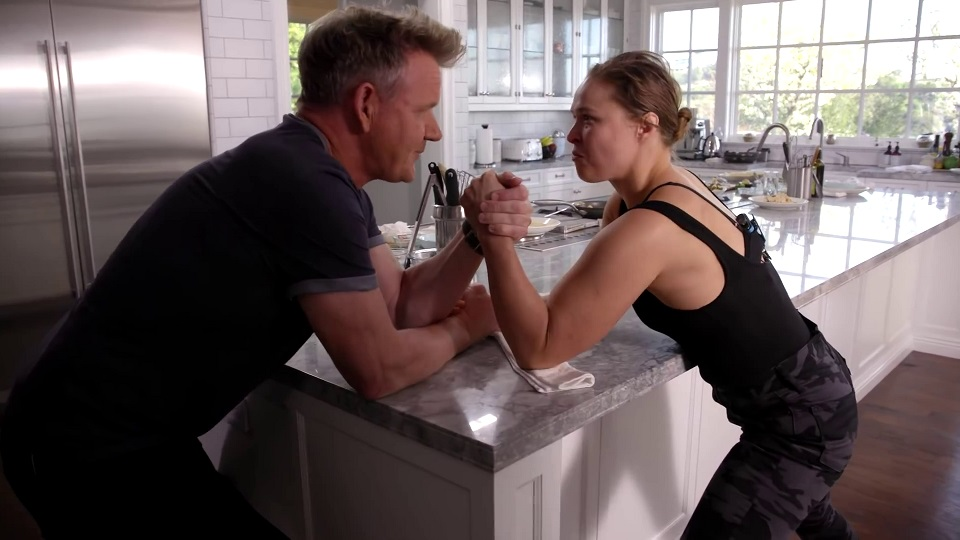 Gordon Ramsay and Ronda Rousey declaring an arm war (source: Gordon Ramsay's YouTube)
