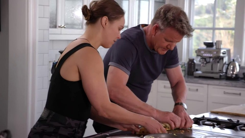 Ronda Rousey and Gordon Ramsay putting the finishing touches on their breakfast burritos (source: Gordon Ramsay's official YouTube channel)